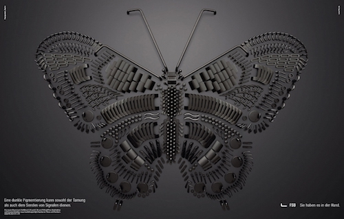 Butterfly image made by assembling hundreds of door handle parts